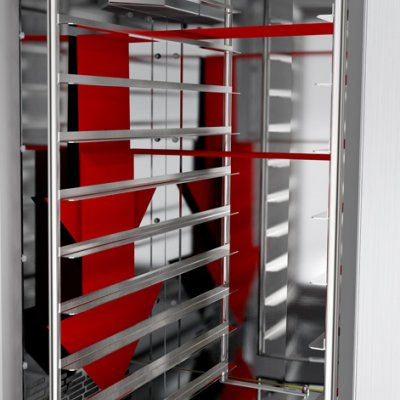 Bakery rack oven with rotating rack and optimal air flow for baking on trays